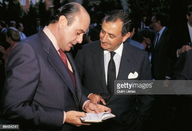 Juan Abello and Juan March bankers Juan Abello looking in a notebook beside Juan March
