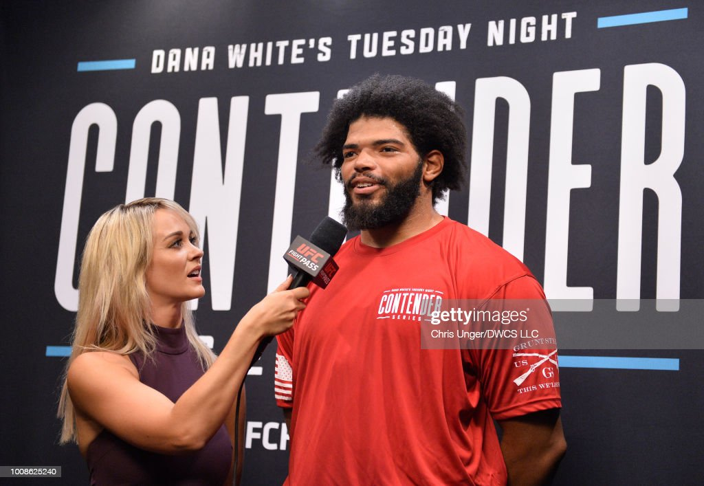Juan Adams is interviewed by Laura Sanko after being awarded a UFC contract during Dana White's Tuesday Night Contender Series at the TUF Gym on July 31, 2018 in Las Vegas, Nevada.