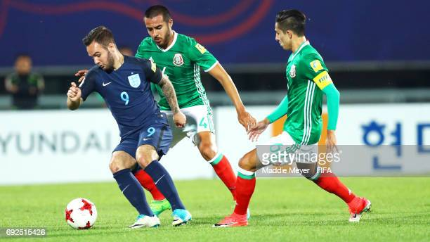 Juan Aguayo of Mexico and Alan Cervantes defend Adam Armstrong of England during the FIFA U20 World Cup Korea Republic 2017 Quarter Final match...