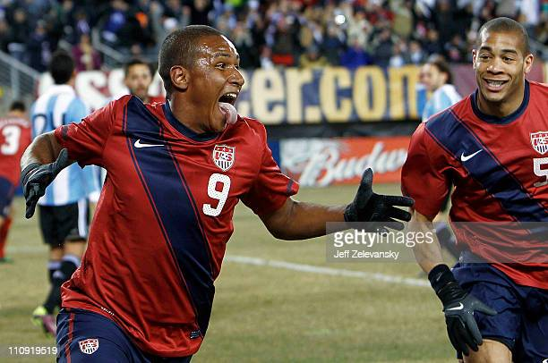 Juan Agudelo and Oguchi Onyewu of the United States celebrate Agudelo's gametying goal during the second half of a friendly match against Argentina...