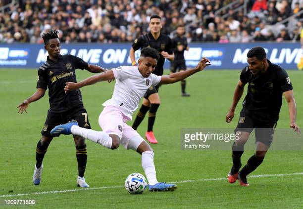 Juan Agudelo of Inter Miami CF attempts a shot in front of Latif Blessing and Eddie Segura of Los Angeles FC during a 10 Los Angeles FC win at Banc...