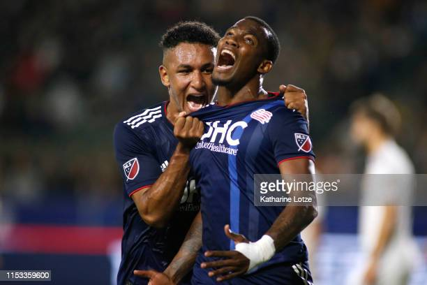 Juan Agudelo of New England Revolution and Cristian Penilla of New England Revolution celebrate Penilla's goal during the first half against the Los...