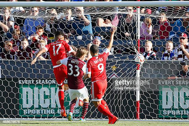 Juan Agudelo of New England Revolution puts the ball in the back of the net for a goal in the 18th minute against Jared Watts of Colorado Rapids as...