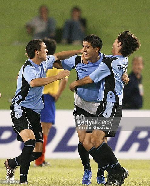 Juan Albin de la seleccion de Uruguay celebra con Danilo Peinado y Leandro Ezguerra su segundo gol ante Ecuador durante el partido por el Campeonato...