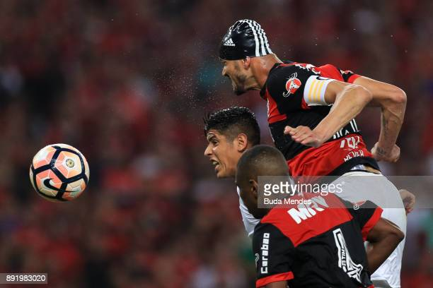 Juan and Rever of Flamengo struggle for the ball with Alan Franco of Independiente during the second leg of the Copa Sudamericana 2017 final between...
