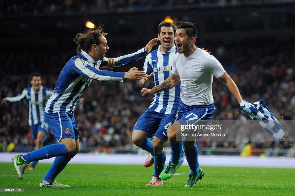 Juan Angel Albin (R) of RCD Espanyol celebrates scoring their second goal with teammates Raul Rodriguez Navarro (2R) and Sergio Garcia (L) during the La Liga match between Real Madrid CF and RCD Espanyol at Estadio Santiago Bernabeu on December 16, 2012 in Madrid, Spain.