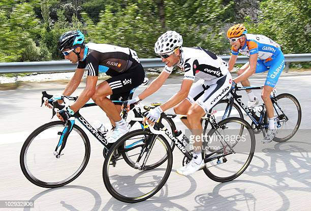 Juan Antonio Flecha of Spain and Team SKY rides with Carlos Sastre of Spain and the Cervelo Test Team and Ryder Hesjedal of Canada and...