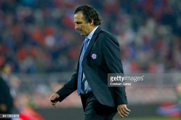 Juan Antonio Pizzi coach of Chile leaves the field after a match between Chile and Paraguay as part of FIFA 2018 World Cup Qualifier at Monumental...