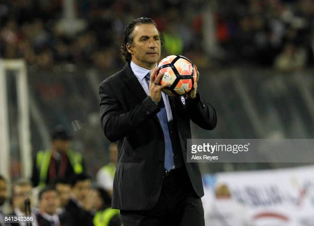 Juan Antonio Pizzi head coach of Chile holds a ball during a match between Chile and Paraguay as part of FIFA 2018 World Cup Qualifiers at Monumental...