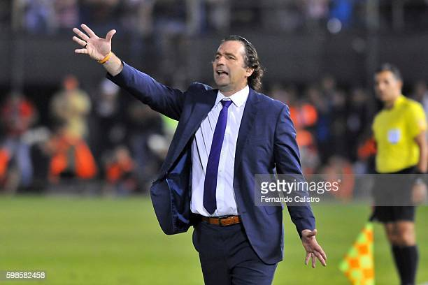 Juan Antonio Pizzi head coach of Chile shouts instructions to his players during a match between Paraguay and Chile as part of FIFA 2018 World Cup...