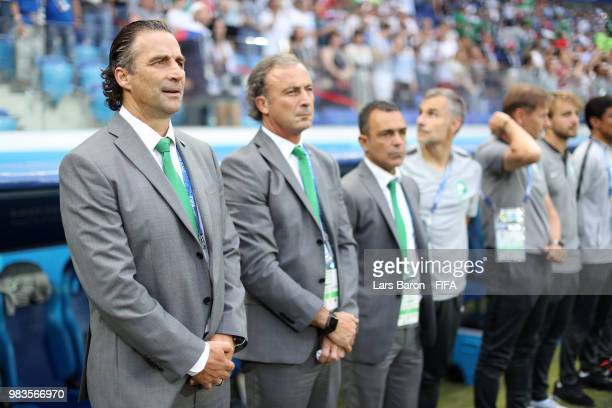 Juan Antonio Pizzi Head coach of Saudi Arabia sings the national anthem prior to the 2018 FIFA World Cup Russia group A match between Saudia Arabia...