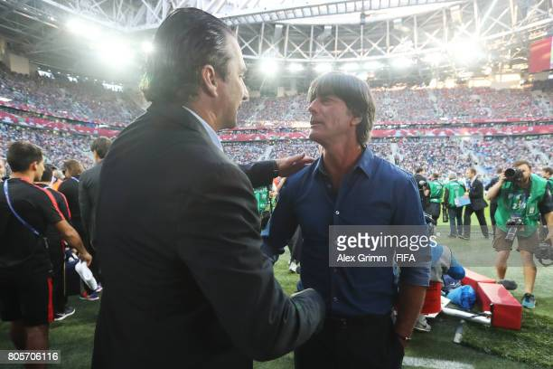 Juan Antonio Pizzi of Chile and Joachim Loew coach of Germany shake hands prior to the FIFA Confederations Cup Russia 2017 Final between Chile and...