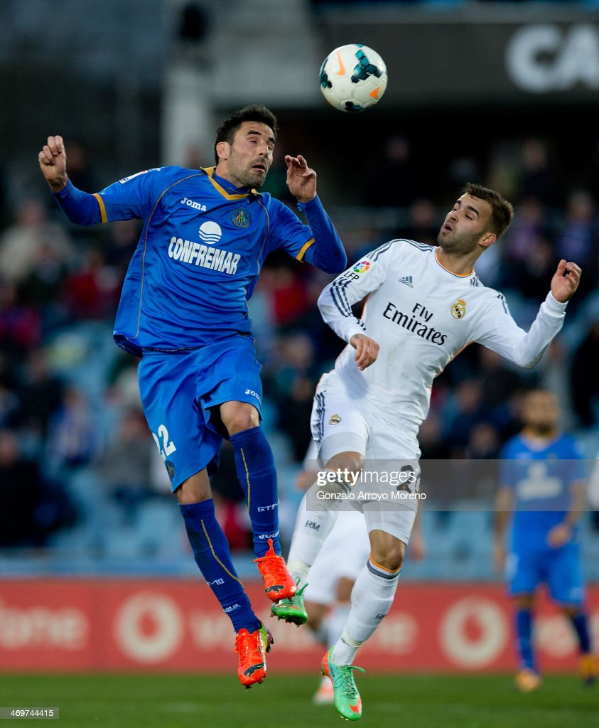 Juan Antonio Rodrguez (L) of Getafe CF competes for the ball with Jese Rodriguez (R) of Real Madrid CF during the La Liga match between Getafe CF and Real Madrid CF at Coliseum Alfonso Perez on February 16, 2014 in Getafe, Spain.