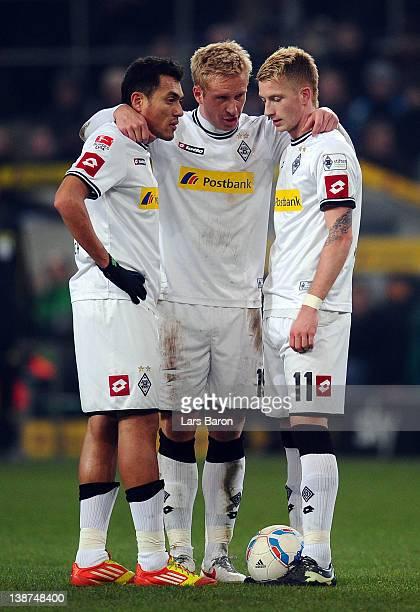 Juan Arango, Mike Hanke and Marco Reus stand together during the Bundesliga match between Borussia Moenchengladbach and FC Schalke 04 at Borussia...