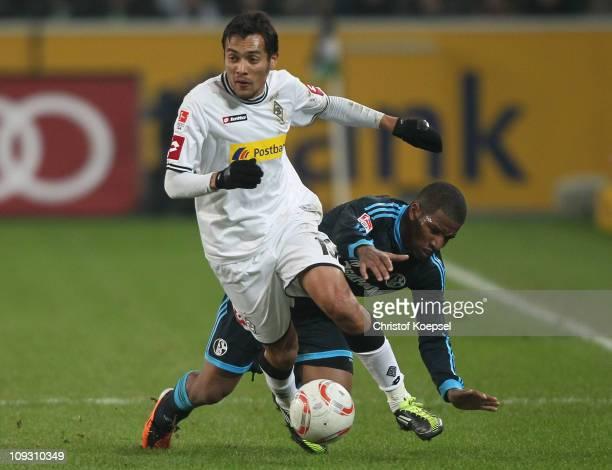 Juan Arango of Gladbach challenges Jeffferson Farfan of Schalke during the Bundesliga match between Borussia Moenchengladbach and FC Schalke 04 at...