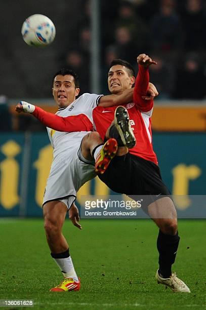 Juan Arango of Moenchengladbach and Malik Fathi of Mainz battle for the ball during the Bundesliga match between Borussia Moenchengladbach and FSV...
