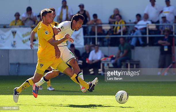 Juan Arango of Moenchengladbach scores his teams first goal during the first round match of the DFB Cup between Alemannia Aachen and Borussia...