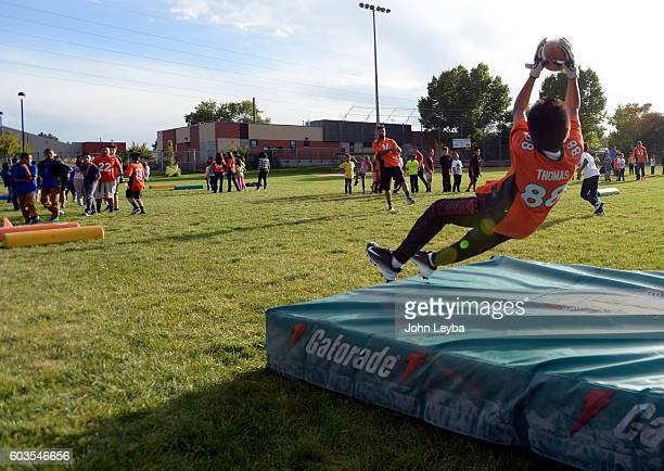 Juan Arias 13 years old goes up high for a pass from Denver Broncos wide receiver Cody Latimer during the Fall 2016 NGL Play 60 The Denver Broncos...