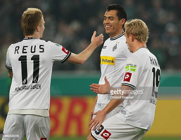 Juan Arrango of Moenchengladbach celebrates the first goal with Marco Reus and Mike Hanke of Moenchengladbach during the DFB Cup round of sixteen...