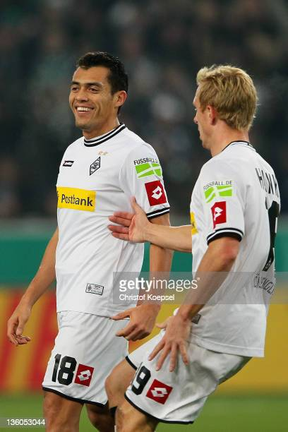 Juan Arrango of Moenchengladbach celebrates the first goal with Mike Hanke of Moenchengladbach during the DFB Cup round of sixteen match between...