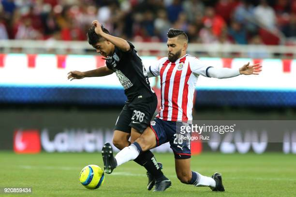 Juan Basulto of Chivas fights for the ball with Erick Sanchez of Pachuca during the 8th round match between Chivas and Pachuca as part of the Torneo...