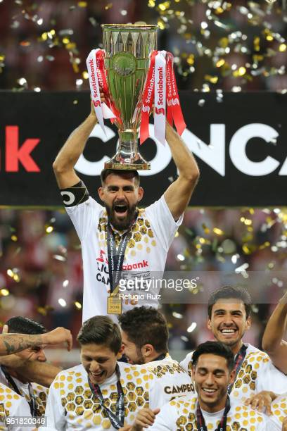 Juan Basulto of Chivas holds up the trophy after winning the second leg match of the final between Chivas and Toronto FC as part of CONCACAF...