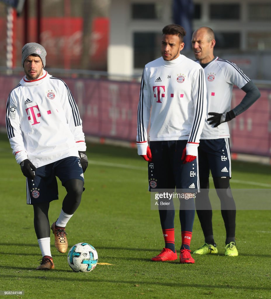 Juan Bernat, Corentin Tolisso and Arjen Robben (L-R) of FC Bayern Muenchen are pictured during a training session at the club's Saebener Strasse training ground on January 10, 2018 in Munich, Germany.