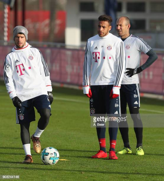 Juan Bernat Corentin Tolisso and Arjen Robben of FC Bayern Muenchen are pictured during a training session at the club's Saebener Strasse training...