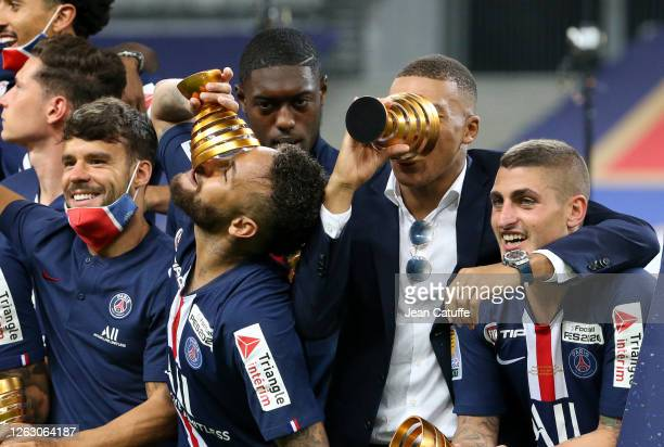 Juan Bernat, Neymar Jr, Kylian Mbappe, Marco Verratti of PSG and teammates celebrate the victory during the trophy ceremony following the French...