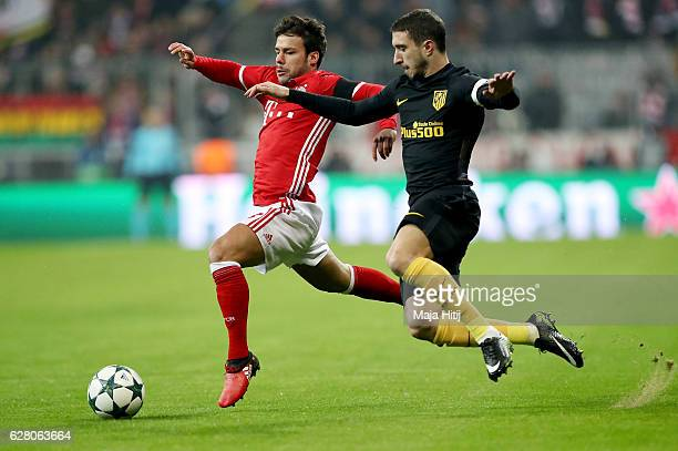 Juan Bernat of Bayern and Gabi of Atletico Madrid battle for the ball during the UEFA Champions League match between FC Bayern Muenchen and Club...
