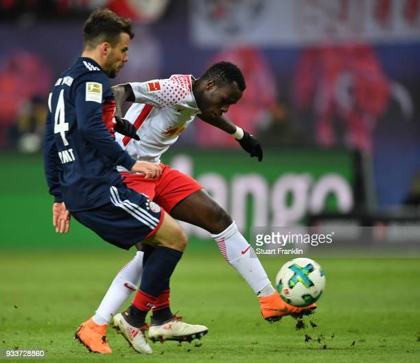 Juan Bernat of Bayern is challenged by Bruma of Leipzig during the Bundesliga match between RB Leipzig and FC Bayern Muenchen at Red Bull Arena on...