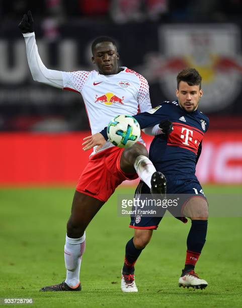 Juan Bernat of Bayern is challenged by Ibrahima KonatŽ of Leipzig during the Bundesliga match between RB Leipzig and FC Bayern Muenchen at Red Bull...