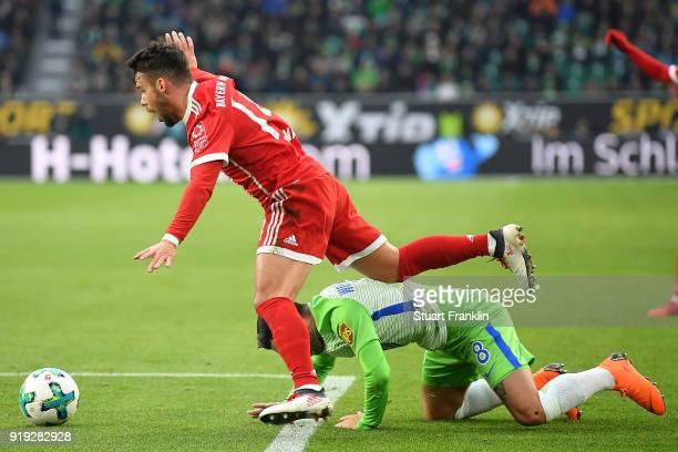 Juan Bernat of Bayern Muenchen fights for the ball with Renato Steffen of Wolfsburg during the Bundesliga match between VfL Wolfsburg and FC Bayern...