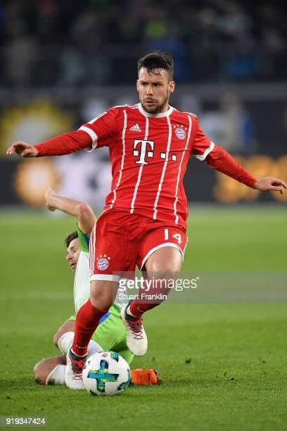 Juan Bernat of Bayern Muenchen is challenged by Renato Steffen of Wolfsburg during the Bundesliga match between VfL Wolfsburg and FC Bayern Muenchen...