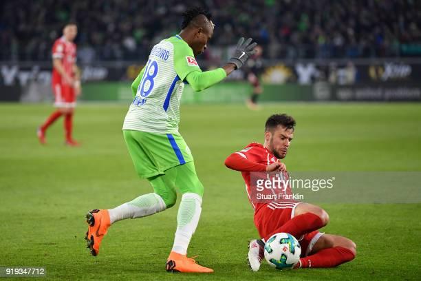 Juan Bernat of Bayern Muenchen is challenged by Victor Osimhen of Wolfsburg during the Bundesliga match between VfL Wolfsburg and FC Bayern Muenchen...