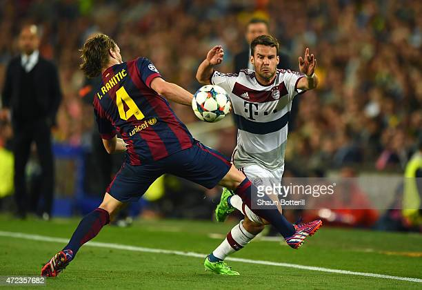 Juan Bernat of Bayern Muenchen is tackled by Ivan Rakitic of Barcelona during the UEFA Champions League Semi Final first leg match between FC...