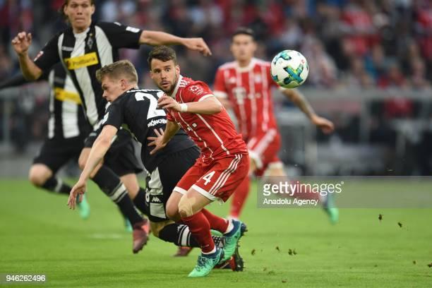 Juan Bernat of Bayern Munich and Matthias Ginter of Borussia Monchengladbach vie for the ball during the German Bundesliga soccer match between FC...
