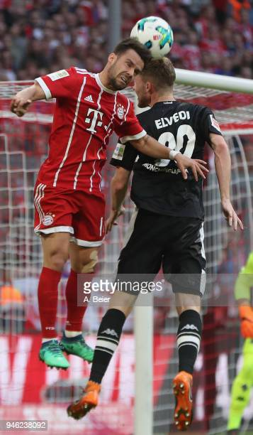 Juan Bernat of FC Bayern Muenchen heads for the ball with Nico Elvedi of Moenchengladbach during the Bundesliga match between FC Bayern Muenchen and...