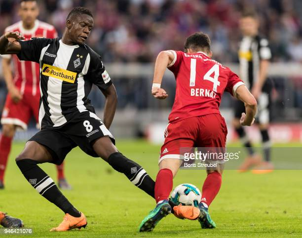 Juan Bernat of FC Bayern Muenchen is challenged by Denis Zakaria of Borussia Moenchengladbach in the box during the Bundesliga match between FC...