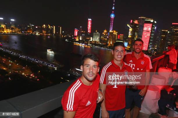 Juan Bernat of FC Bayern Muenchen poses with James Rodriguez and Javier Martinez for a picture with the Shanghai Bund in the background during the...