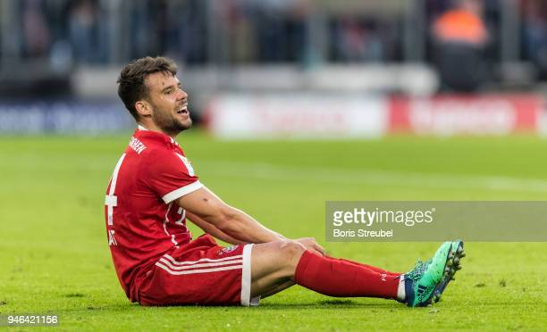 Juan Bernat of FC Bayern Muenchen sits on the pitch during the Bundesliga match between FC Bayern Muenchen and Borussia Moenchengladbach at Allianz...
