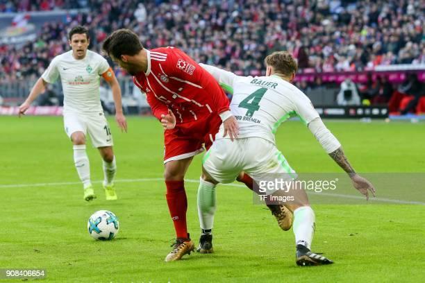Juan Bernat of Muenchen and Robert Bauer of Bremen battle for the ball during the Bundesliga match between FC Bayern Muenchen and SV Werder Bremen at...