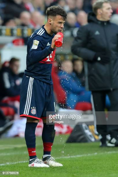 Juan Bernat of Muenchen drinks during the Bundesliga match between 1 FSV Mainz 05 and FC Bayern Muenchen at Opel Arena on February 3 2018 in Mainz...
