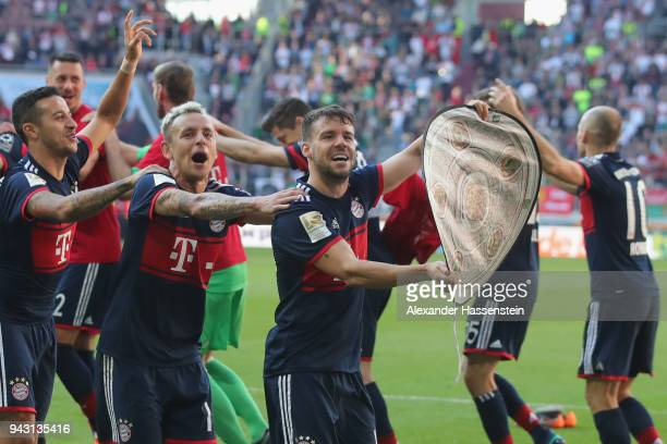 Juan Bernat of Muenchen leads the team as they celebrate in front of their supporters winning the Bundesliga championship after the Bundesliga match...