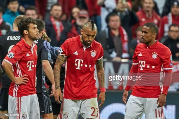 Juan Bernat of Munich Arturo Vidal of Munich and Douglas Costa of Munich looks on during the UEFA Champions League Quarter Final first leg match...