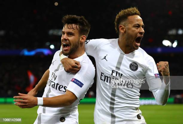 Juan Bernat of Paris SaintGermain celebrates after scoring his sides first goal with Neymar of Paris SaintGermain during the UEFA Champions League...