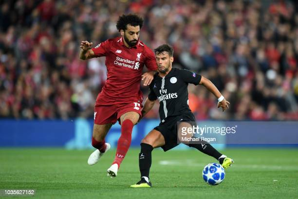 Juan Bernat of Paris SaintGermain is challenged by Mohamed Salah of Liverpool during the Group C match of the UEFA Champions League between Liverpool...