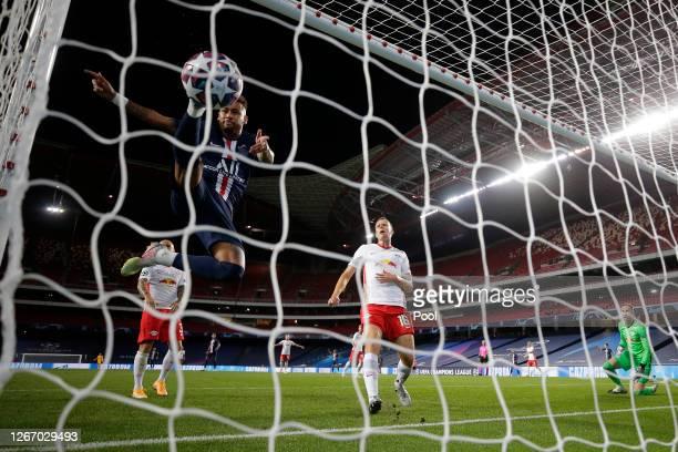 Juan Bernat of Paris Saint-Germain scores his team's third goal as Neymar of Paris Saint-Germain attempts to kick the ball over the line during the...