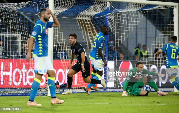 Juan Bernat of PSG celebrates his goal while goalkeeper of Napoli David Ospina looks on during the Group C match of the UEFA Champions League between...