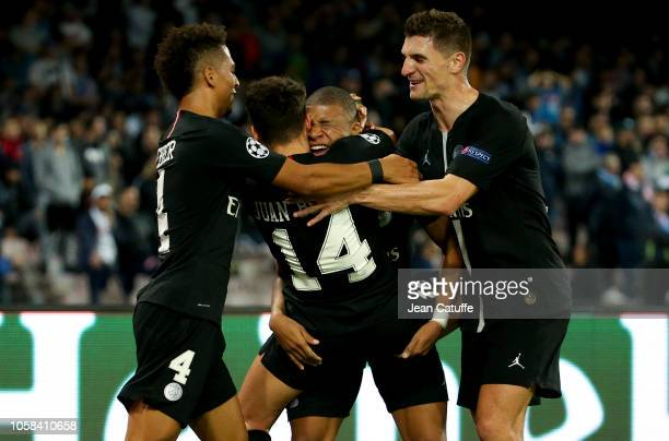 Juan Bernat of PSG celebrates his goal with Thilo Kehrer Kylian Mbappe Thomas Meunier during the Group C match of the UEFA Champions League between...